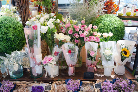 Beautiful flowers in flower shop. Bouquets of beautiful flower on the table.