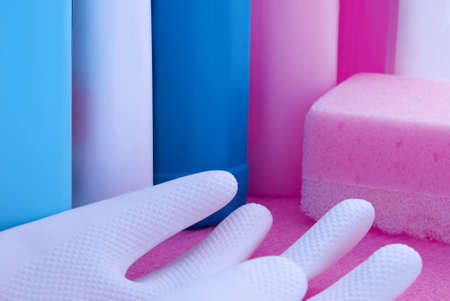 cleaning supplies: white and pink cleaning supplies with rubber glove and sponge