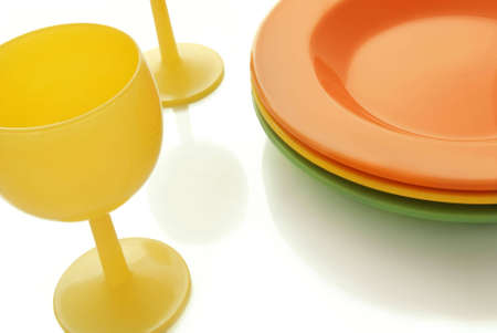 bocal: closeup of a place setting with color ceramics plates and a wine glass