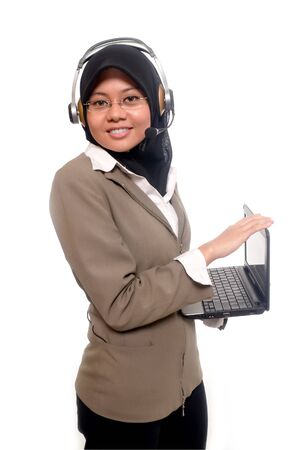 nicely: a beauty operator hold laptop with nicely smile Stock Photo