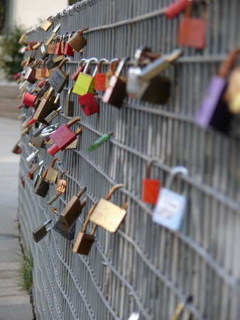 Love locks on a wire fence Banco de Imagens