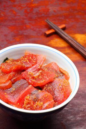 thunnus: Vinegared rice topped with sliced raw tuna, Japanese food