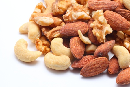 Mixed nuts on white background photo