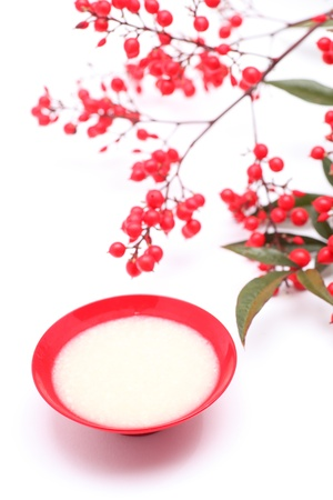 mild: Japanese sweet mild sake and nandina domestica Stock Photo