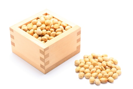 Soybeans in the wooden square cup on white background