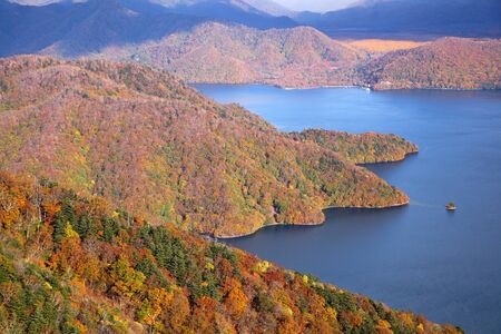 Autumn colours of Lake Chuzenji in Nikko, Japan  photo