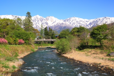 Mt. Shiroumadake and Himekawa River in Hakuba Village, Nagano, Japan photo