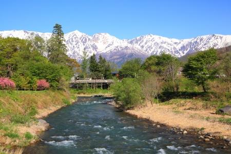 early spring snow: Mt. Shiroumadake and Himekawa River in Hakuba Village, Nagano, Japan Stock Photo
