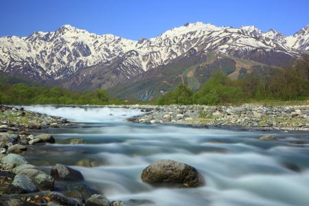 Mt. Goryudake and Matsukawa River in Hakuba Village, Nagano, Japan photo
