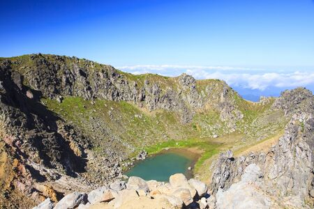 crater lake: Crater lake of Mt. Yakedake, Japan Alps Stock Photo