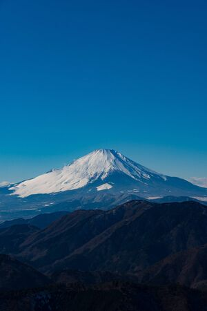Mt. Fuji covered with snow. and The paraglider which the sky is high, and dances. -For New Years cards-