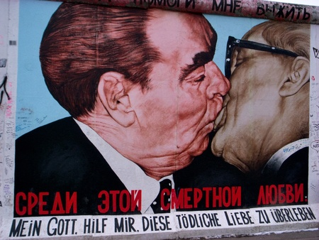 murals: berlin germany, 20 february 2011:one of the most famous murals of the berlin wall, two known characters, two men who are kissing passionately
