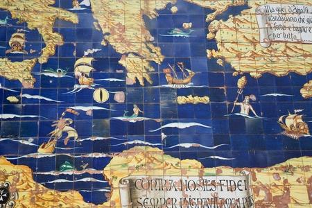 amalfi, italy - 4 april 2009: map illustrating of mythological mediterranean sea along the wall of amalfi.