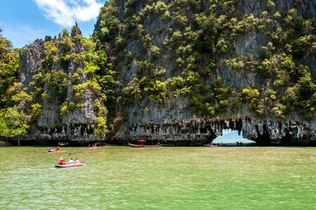 Canoeing through the cave at Phang nga bay, Thailand photo