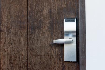 木製の扉に電気錠を組み立てる 写真素材