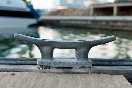 cleat: Empty cleat for boat belay at the marina