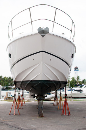 drydock: Small motorboat waiting for a maintenance at a shipyard