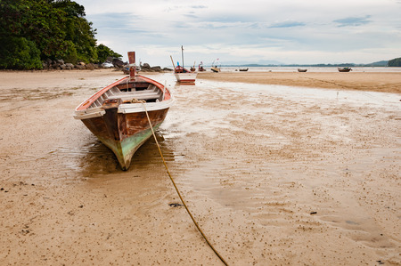 desertification: Abandoned old wooden wreck boat on the beach in Phuket, Thaialnd Stock Photo