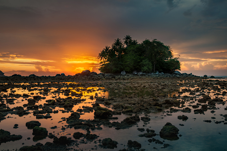 kelor: Small island by the sea with the beautiful colorful sunset