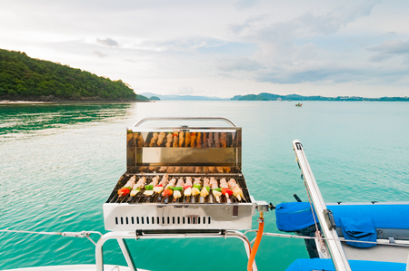 boat party: Barbecue grill on the boat. Luxury boat party before sunset in Phuket, Thaialnd Stock Photo