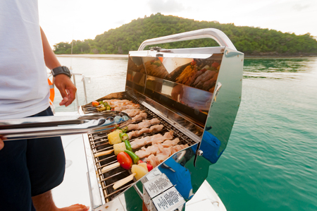 Barbecue preparing for a party on the luxury catamaran yacht in Phuket, Thailand Stock Photo