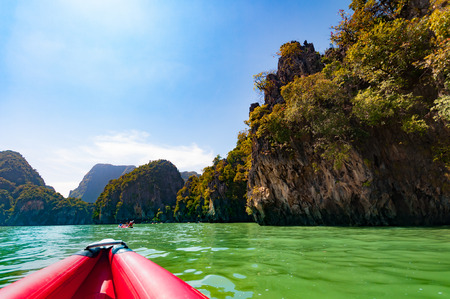 Phang nga bay a beautiful scenic with  large limestone rock and tourists canoeing, Thailand