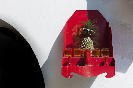 home accents: Pineapple worship on a  Buddha shelf out door