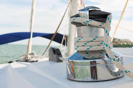 yachting: Sailboat Winch and Rope closeup Catamaran Yacht detail. Yachting, Phuket, Thailand