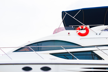 Front deck of the yacht with red lifebuoy