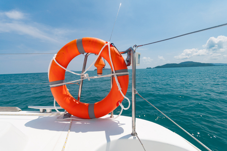 Orange lifebuoy on the yacht preparing for a safety