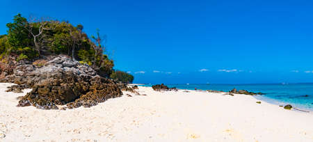 Tropical sandy beach panorama with big rocks in the island, Phi Phi island, Krabi, Thailand