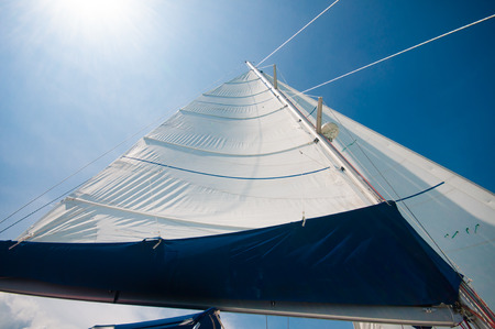 Sailing yachts in a smooth wind with sunny blue sky day