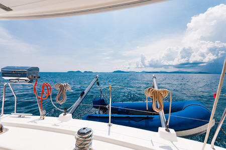 dingy: Rear of the luxury yacht with dingy and BBQ party equipment