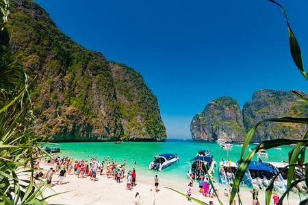 overcrowded: Uncontrol of tourist numbers in high season, destroying Phi Phi islands and other tourist attraction spots around in Krabi Thailand.