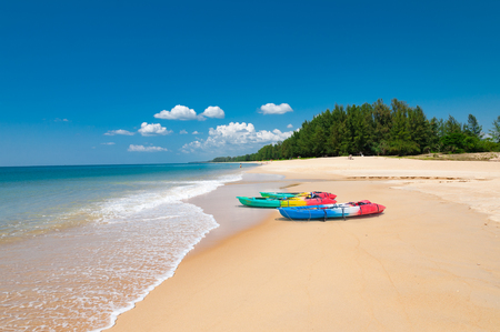 phangnga: Colorful kayaks on the tropical beach and calm blue sea in Phuket island, Thailand Stock Photo