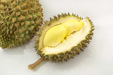 Durian on a white plate with green spikes rind  and yellow background, king of the fruit but smelly in Thailand and south east asia; soft  focus Zdjęcie Seryjne - 78667623