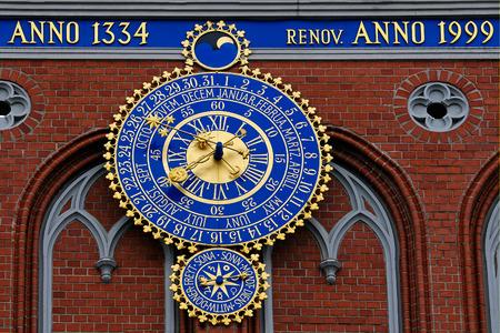 riga: Clock on Schwarzhaeupterhaus, Riga, Latvia Editorial