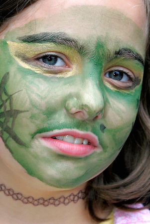 face paint: girl with green face paint Stock Photo