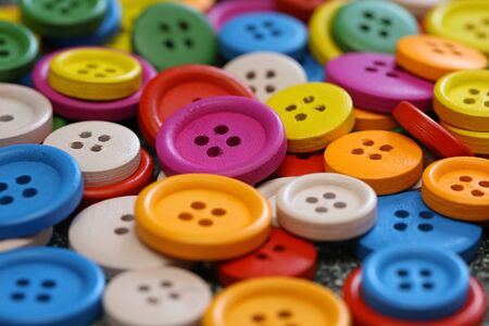 Colorful buttons on a marble table Standard-Bild