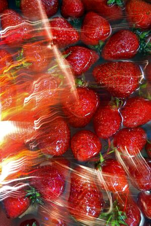 Strawberries with light reflections