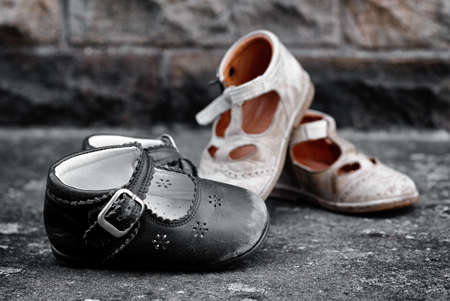worn children's shoes, two pairs