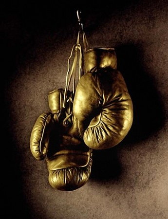 leather glove: Photo of boxing gloves hanging on the wall