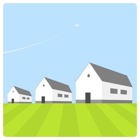 huizen onder de blauwe hemel