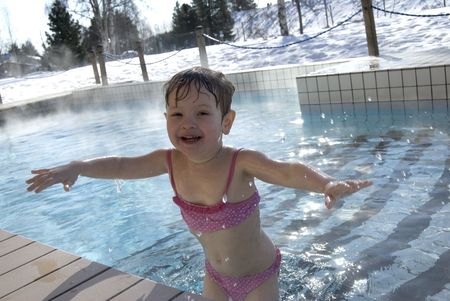 pool preteen: Child in the winter sweeming pool