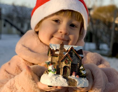 Beautiful christmas girl with little house
