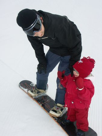 children on the  snowboard: little syster and brouther Stock Photo