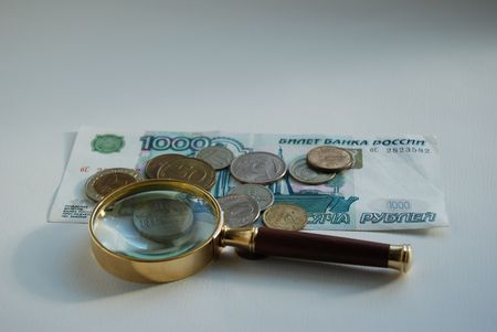 magnifying and money