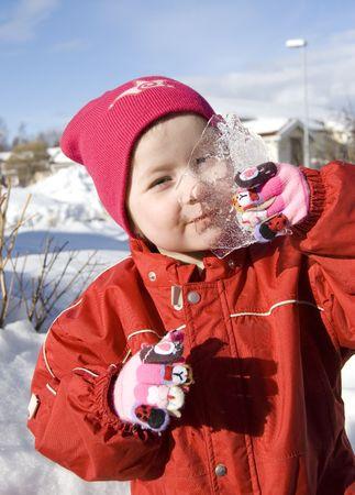 Beautiful girl and ice photo