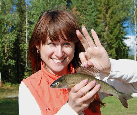 Young woman with a fish Stock Photo