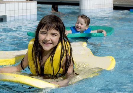 playful girls in swimming pool photo